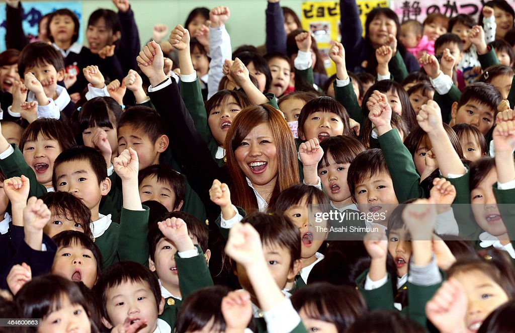 Mogul skiier Arisa Murata, who works for Gyogaku Kindergarten as a teacher, poses for photographs with pupils during the sending-off party on January 22, 2014 in Kitakyushu, Fukuoka, Japan. Murata, who is a member of Japanese women's mogul team for Sochi Olympic next month, became a qualified kindergarten teacher after graduating a college last spring and has been working for her parents run kindergarten a few days a month though she usually lives in Hokkaido for training.