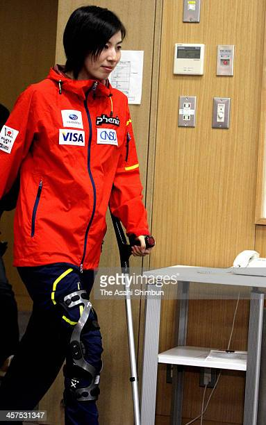 Mogul skiier Miki Ito enters a conference room with a crutch on December 16 2013 in Tokyo Japan