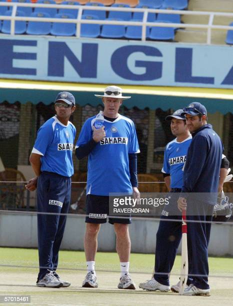 Indian cricket team captain Rahul Dravid coach Greg Chappell and players Sachin Tendulkar and Virender Sehwag inspect the pitch during a practise...