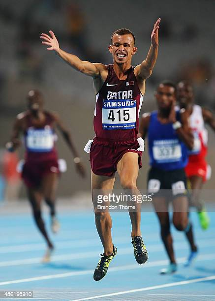 Mohamad Al Garni of Qatar celebrates after claiming the Gold medal following the Mens's 5000m Final during day eight of the 2014 Asian Games at...