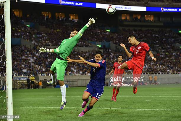Mohamad Izwan Bin Mahbud of Singapore punches out the ball during the 2018 FIFA World Cup Asian Qualifier second round match between Japan and...