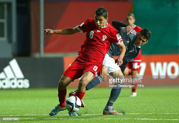 Mohamad Loulou of Syria and Julio Villalba of Paraguay vie for the ball during the Syria v Paraguay Group F FIFA U17 World Cup Chile 2015 match at...