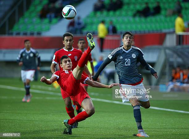 Mohamad Loulou of Syria volleys the ball clear from Julio Villalba of Paraguay during the Syria v Paraguay Group F FIFA U17 World Cup Chile 2015...
