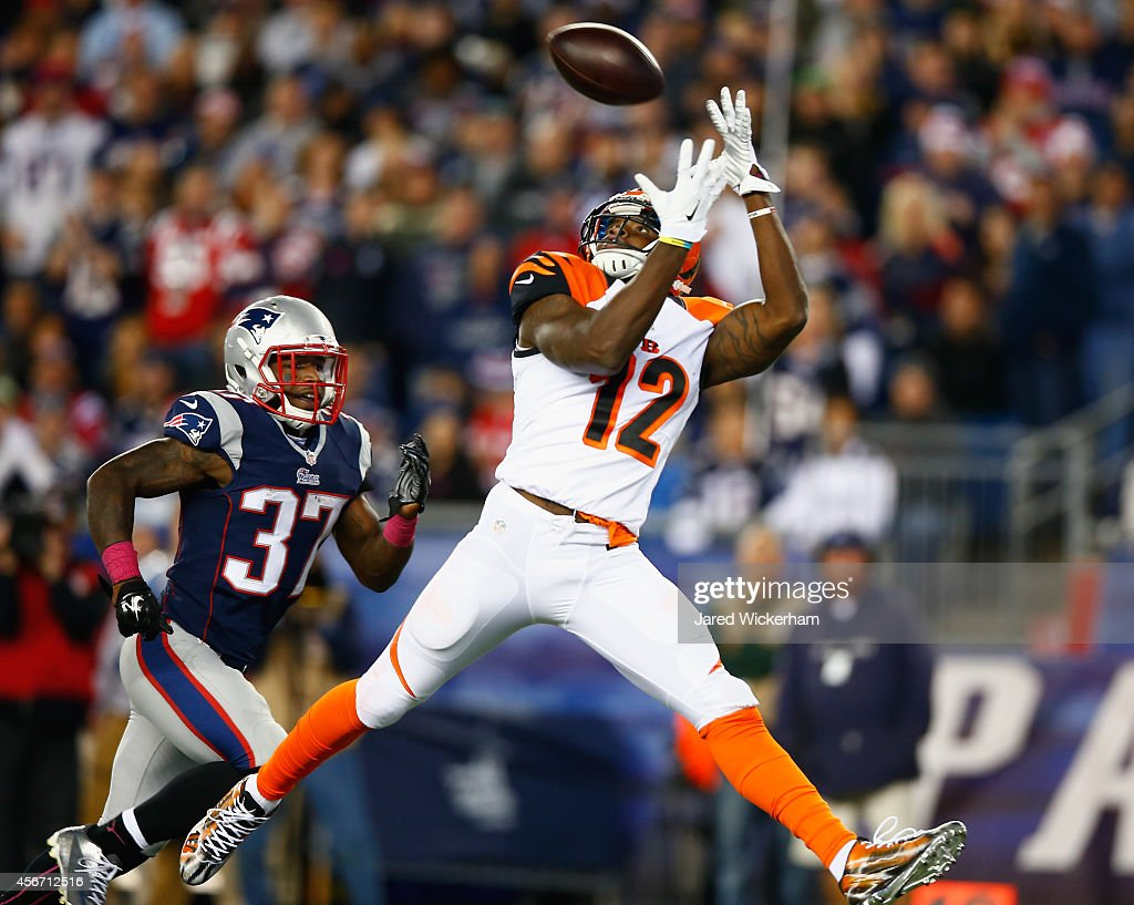Mohamad Sanu #12 of the Cincinnati Bengals catches a touchdown pass as <a gi-track='captionPersonalityLinkClicked' href=/galleries/search?phrase=Alfonzo+Dennard&family=editorial&specificpeople=5651216 ng-click='$event.stopPropagation()'>Alfonzo Dennard</a> #37 of the New England Patriots defends during the third quarter at Gillette Stadium on October 5, 2014 in Foxboro, Massachusetts.