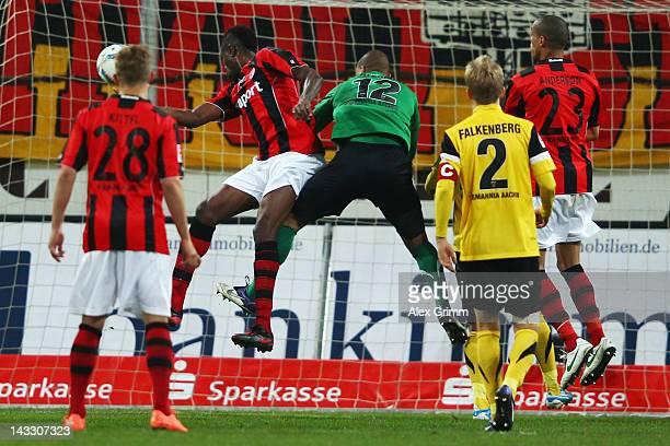 Mohamadou Idrissou of Frankfurt scores his team's first goal against goalkeeper Boy Waterman of Aachen during the Second Bundesliga match between...