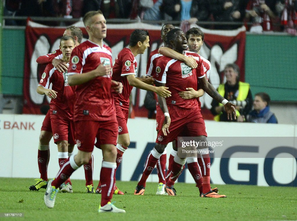 Mohamadou Idrissou of Kaiserslautern celebrates after scoring his teams first goal during the DFB Cup 2nd round match between 1.FC Kaiserslautern and Hertha BSC Berlin at Fritz-Walter-Stadion on September 25, 2013 in Kaiserslautern, Germany.