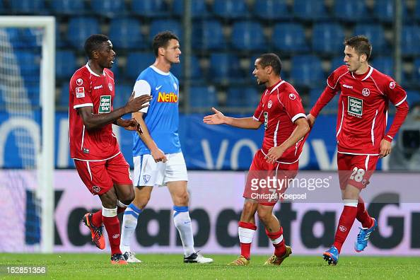 Mohamadou Idrissou of Kaiserslautern celebrates the second goal with Mimoun Azaouagh of Kaiserslautern and Konstantinos Fortounis of Kaiserslautern...