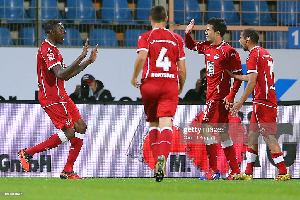 Mohamadou Idrissou of Kaiserslautern celebrates the second goal with Ariel Borysiuk Ilian Micanski and Mimoun Azaouagh of Kaiserslautern during the...
