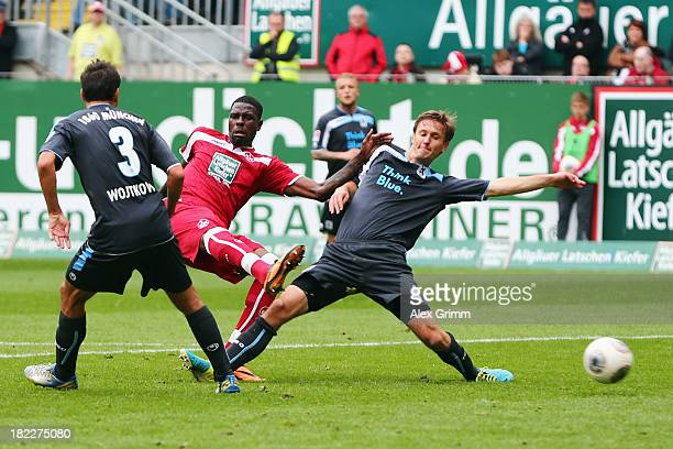 Mohamadou Idrissou of Kaiserslautern scores his team's third goal against Grzegorz Wojtkowiak and Kai Buelow of Muenchen during the Second Bundesliga...