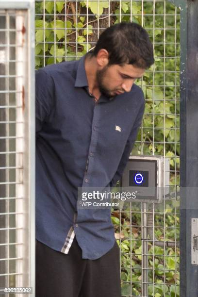 Salah El Karib suspected of involvement in the terror cell that carried out twin attacks in Spain is escorded by Spanish Civil Guards from a...