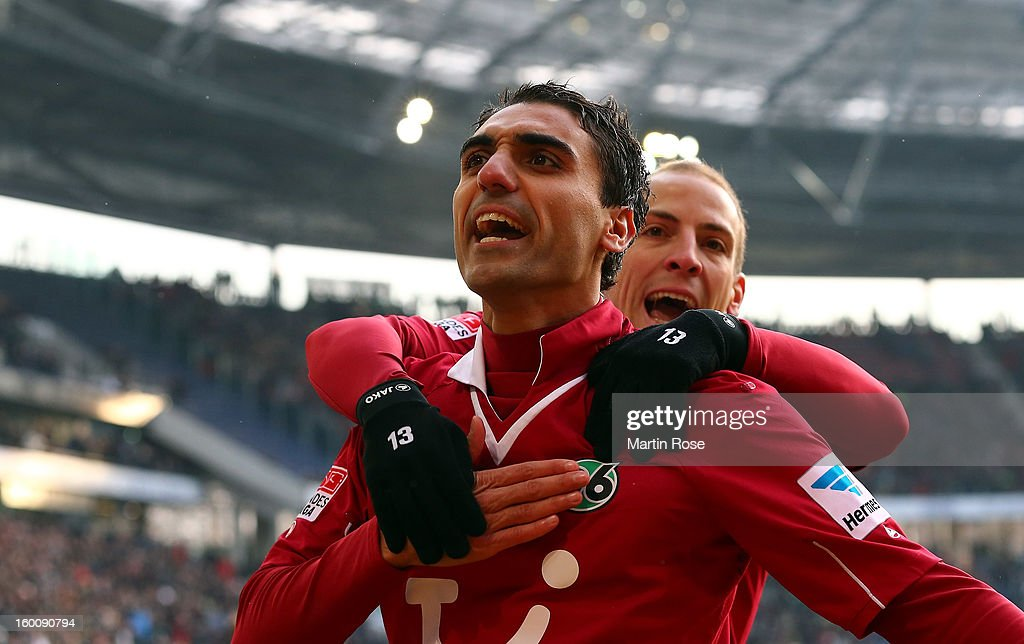 Mohamed Abdellaoue (L) of Hannover celebrate with team mate <a gi-track='captionPersonalityLinkClicked' href=/galleries/search?phrase=Jan+Schlaudraff&family=editorial&specificpeople=673697 ng-click='$event.stopPropagation()'>Jan Schlaudraff</a> after he scores his team's opening goal during the Bundesliga match between Hannover 96 and VfL Wolfsburg at AWD Arena on January 26, 2013 in Hannover, Germany.