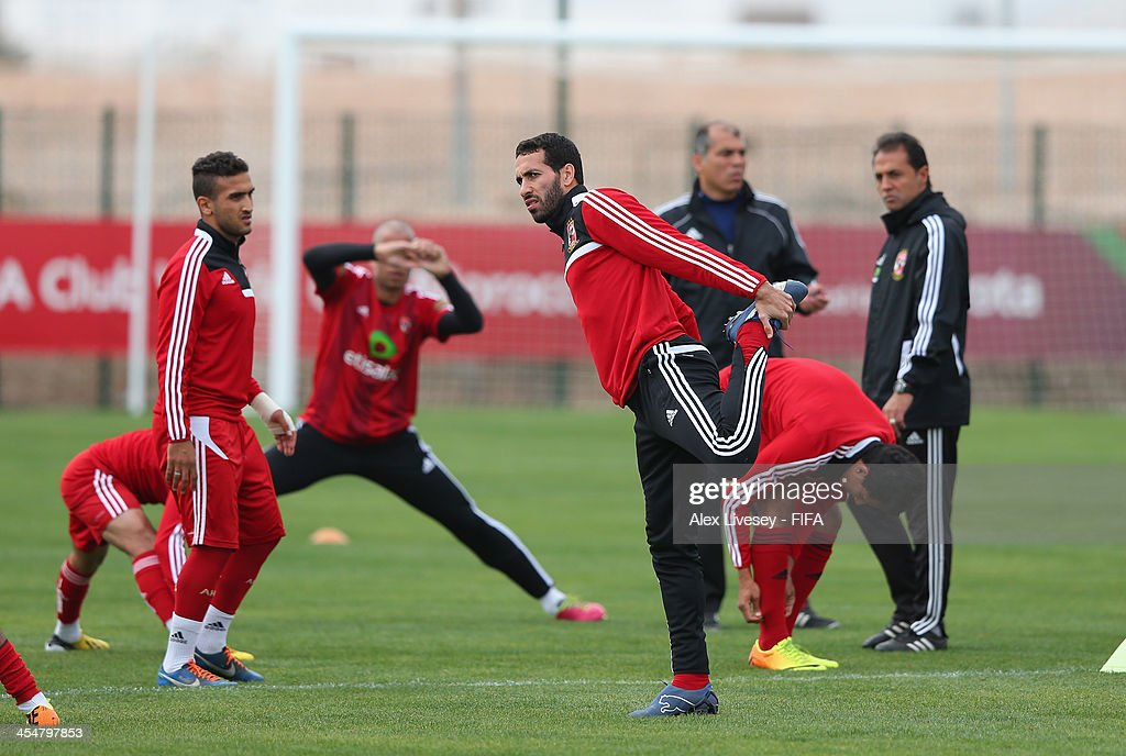 Mohamed Aboutreika of Al Ahly Sport Club stretches during a training session at the Agadir Stadium on December 10 2013 in Agadir Morocco
