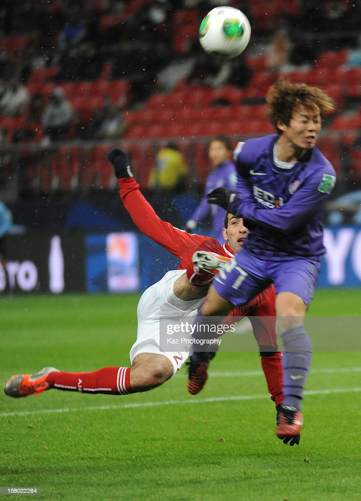 Mohamed Aboutrika's shoot of Al-Ahly blocked by Kohei Shimizu of Sanfrecce Hiroshima during the FIFA Club World Cup Quarter Final match between Sanfrecce Hiroshima and Al-Ahly SC at Toyota Stadium on December 9, 2012 in Toyota, Japan.