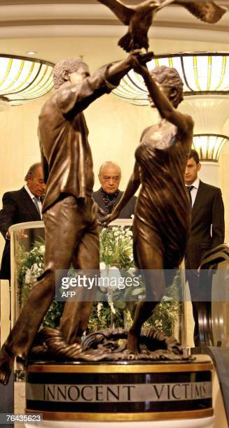 Mohamed Al Fayed and his family observe a twominute silence in memory of Dodi Al Fayed and Diana Princess of Wales at Harrods Department Store in...