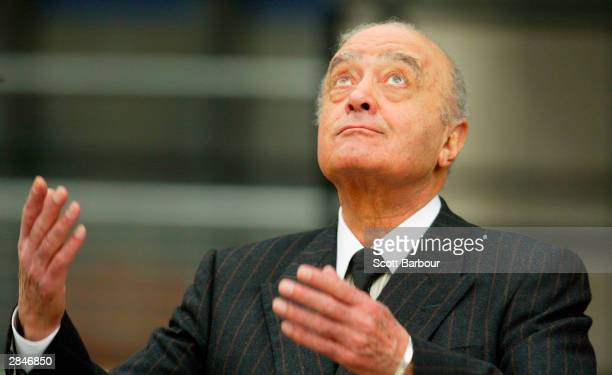 Mohamed Al Fayed gestures as he leaves after attending the opening of the inquest into the death of Diana Princess Of Wales on January 06 2004 in...