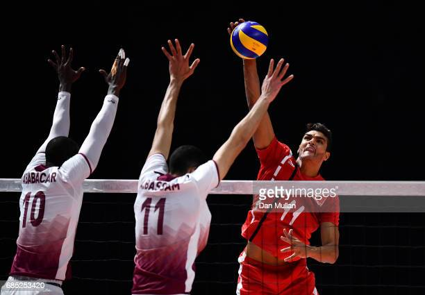 Mohamed Al Hachdadi of Morocco spikes the ball in the Mens Volleyball Group B match between Qatar and Morocco during day eight of Baku 2017 4th...