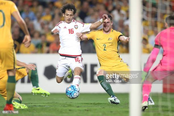 Mohamed Alraqi of the United Arab Emirates shoots at goal under pressure from Milos Degenek of the Socceroos during the 2018 FIFA World Cup Qualifier...