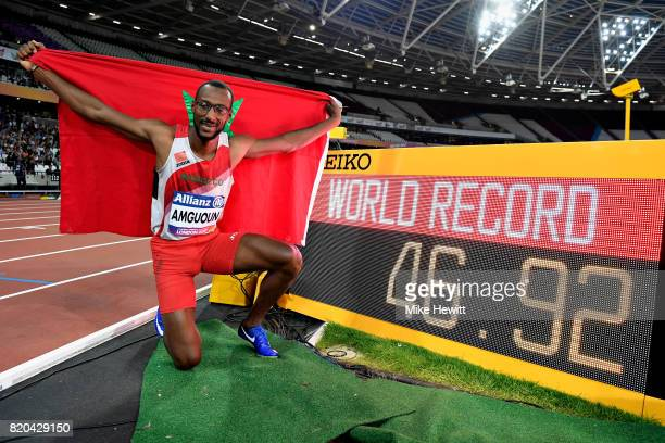 Mohamed Amguoun of Morocco poses for a photo next to his world record time of 4692 seconds that he set in the Mens 400m T13 final during day eight of...