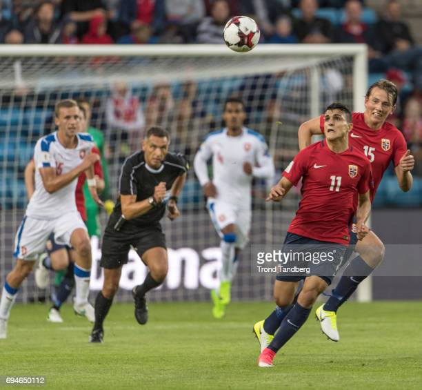 Mohamed Amine Elyounoussi Sander Gard Bolin Berge of Norway Referee Andre Marriner of Great Britain during the FIFA 2018 World Cup Qualifier between...