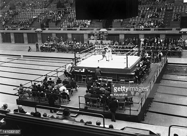 Mohamed Ammi of France takes on Peter Brander of Great Britain in match 8 of the first round of the men's featherweight boxing competition at the...