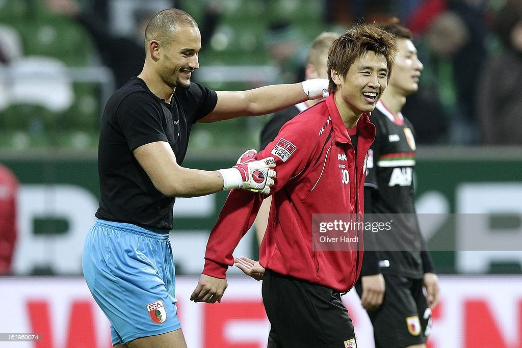 Mohamed Amsif (L) and Ja Cheol Koo (R) of Augsburg celebrate after the Bundesliga match between SV Werder Bremen and FC Augsburg at Weser Stadium on March 2, 2013 in Bremen, Germany.
