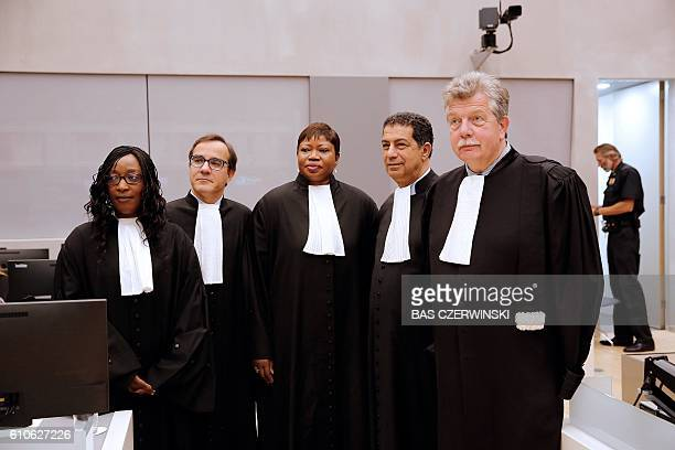 Mohamed Aouini and JeanLouis Gilissen the lawyers of Ahmad Al Faqi Al Mahdi and the Chief Prosecutor Fatou Bensouda stand in the International...