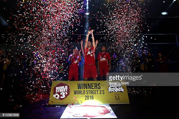 Mohamed Attaibi of the Netherlands holds the trophy aloft after his team won the World Street Soccer Championships during the Soccerex Football...