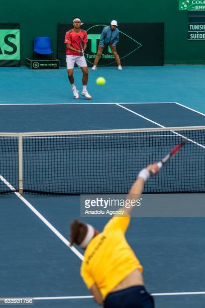 Mohamed Aziz Dougaz of Tunisia in action against Isak Arvidsson of Sweden during the second round single tennis match of the Davis Cup's Europe and...