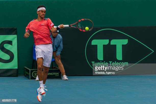 Mohamed Aziz Dougaz of Tunisia returns the ball to Isak Arvidsson of Sweden during the second round single tennis match of the Davis Cup's Europe and...