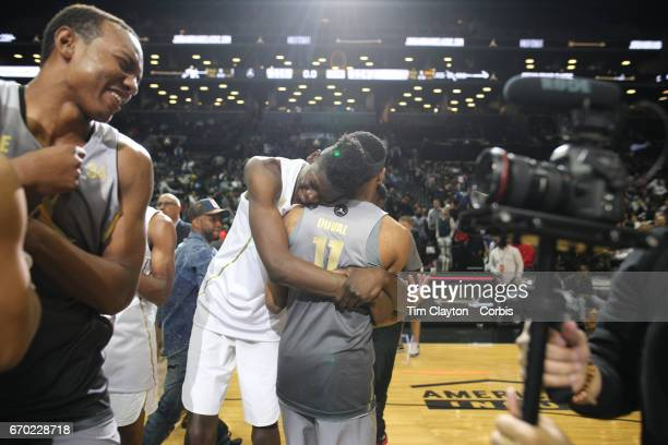 Mohamed Bamba hugs his opposite number Trevon Duval at the end of the game during the Jordan Brand Classic National Boys Team AllStar basketball game...