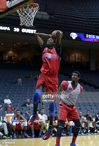 Mohamed Bamba in red goes for a dunk during the NBPA Top 100 Camp on June 18 2015 at John Paul Jones Arena in Charlottesville Virginia