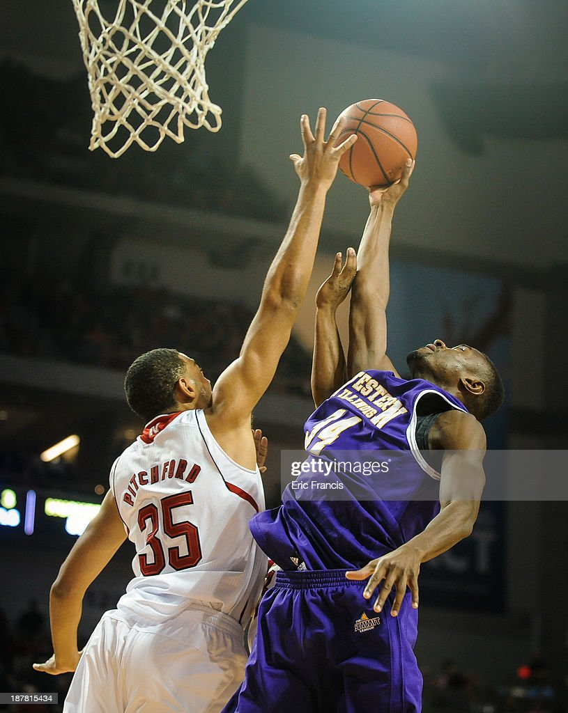 Mohamed Conde #34 of the Western Illinois Leathernecks fights for a rebound with Walter Pitchford #35 of the Nebraska Cornhuskers during their game at Pinnacle Bank Arena on November 12, 2013 in Lincoln, Nebraska.
