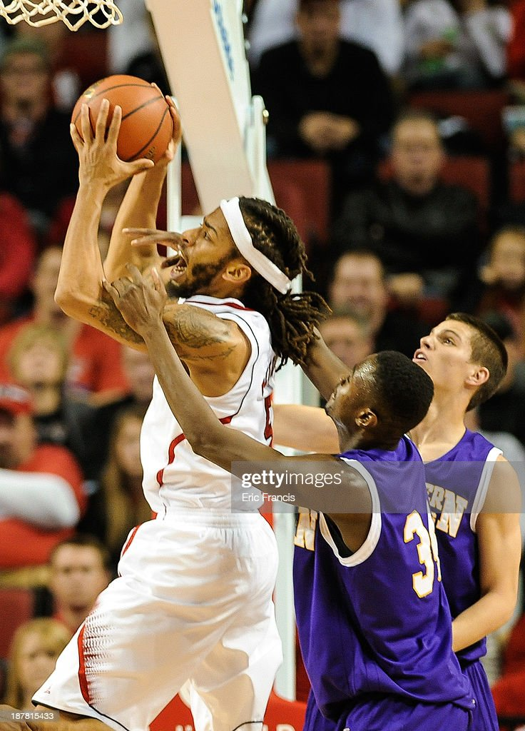 Mohamed Conde #34 of the Western Illinois Leathernecks fouls Terran Petteway #5 of the Nebraska Cornhuskers during their game at Pinnacle Bank Arena on November 12, 2013 in Lincoln, Nebraska.