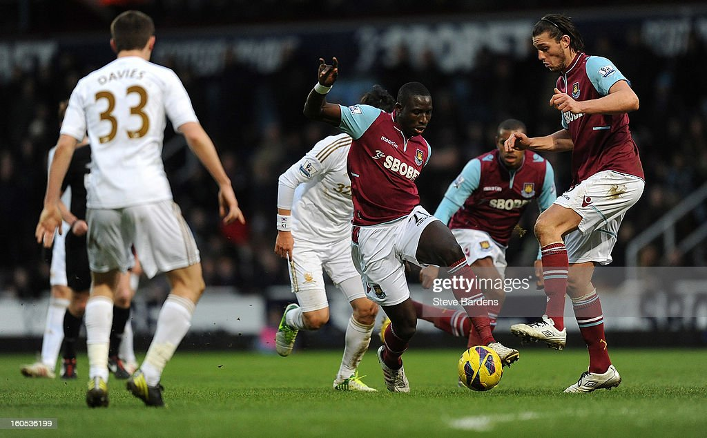 Mohamed Diame (L) and Andy Carroll (R) of West Ham United challenge each other for the ball during the Barclays Premier League match between West Ham United and Swansea at the Boleyn Ground on February 2, 2013 in London, England.