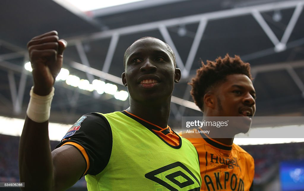 Mohamed Diame and <a gi-track='captionPersonalityLinkClicked' href=/galleries/search?phrase=Chuba+Akpom&family=editorial&specificpeople=8082058 ng-click='$event.stopPropagation()'>Chuba Akpom</a> of Hull City celebrate after the Sky Bet Championship Play Off Final match between Hull City and Sheffield Wednesday at Wembley Stadium on May 28, 2016 in London, England.