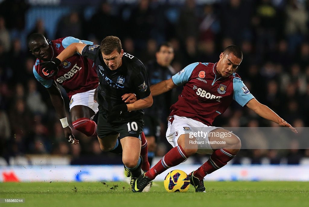 Mohamed Diame (L) and <a gi-track='captionPersonalityLinkClicked' href=/galleries/search?phrase=Winston+Reid&family=editorial&specificpeople=5491819 ng-click='$event.stopPropagation()'>Winston Reid</a> of West Ham United challenge <a gi-track='captionPersonalityLinkClicked' href=/galleries/search?phrase=Edin+Dzeko&family=editorial&specificpeople=4404455 ng-click='$event.stopPropagation()'>Edin Dzeko</a> of Manchester City during the Barclays Premier League match between West Ham United and Manchester City at the Boleyn Ground on November 3, 2012 in London, England.