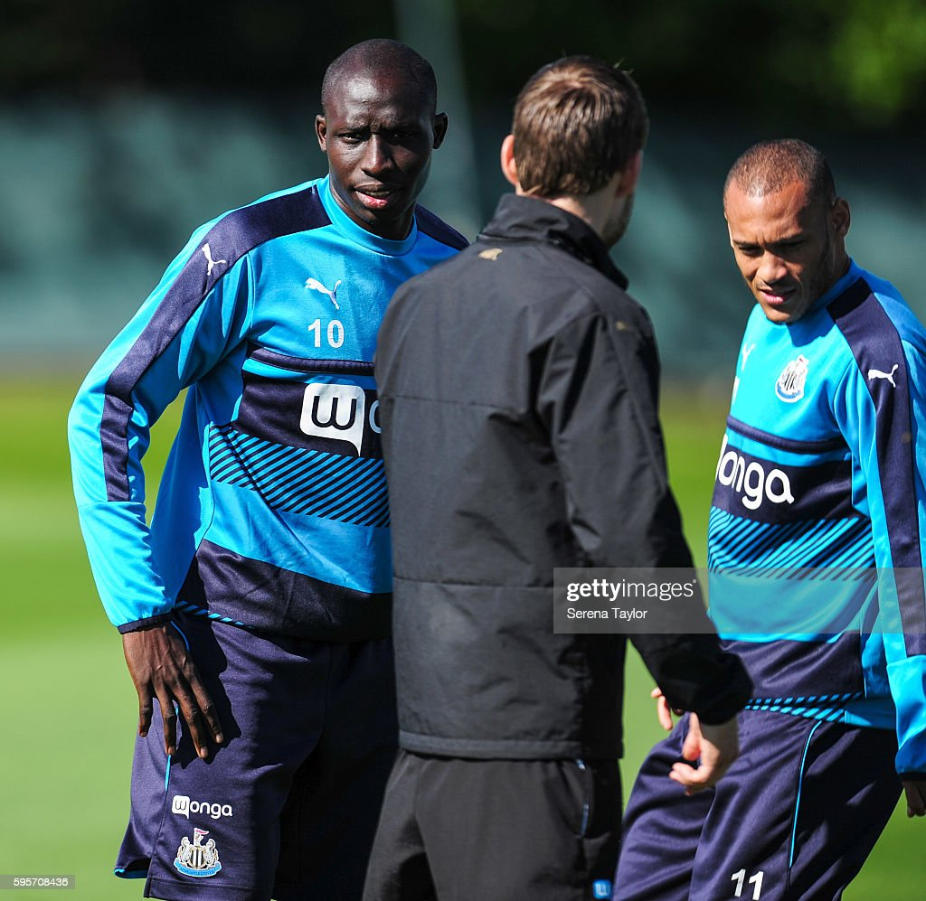 Mohamed Diame and Yoan Gouffran speaks to Sports Scientist Jamie Harley during the Newcastle United Training Session at The Newcastle United Training...
