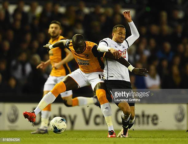 Mohamed Diame of Hull City battles with Marcus Olsson of Derby County during the Sky Bet Championship match between Derby County and Hull City on...