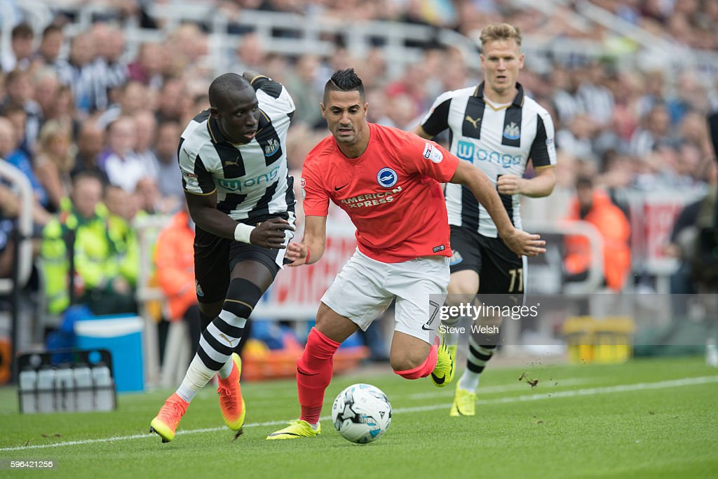 Mohamed Diame of Newcastle challenges Beram Kayal of Brighton during the Premier League match between Newcastle United and Brighton & Hove Albion on August 27, 2016 in Newcastle.
