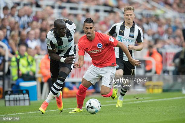 Mohamed Diame of Newcastle challenges Beram Kayal of Brighton during the Premier League match between Newcastle United and Brighton Hove Albion on...
