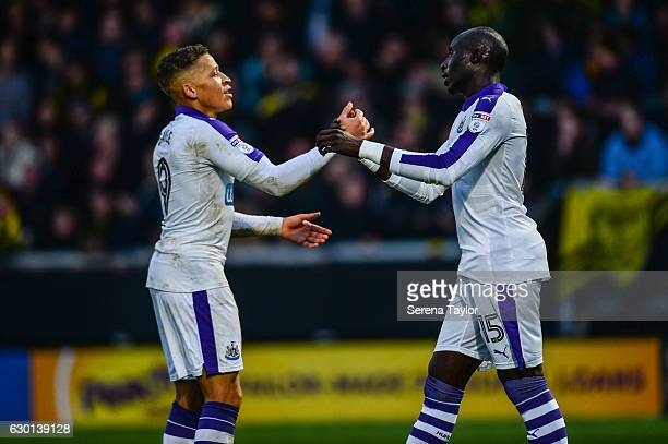 Mohamed Diame of Newcastle United celebrates with teammate Dwight Gayle after scoring Newcastle's second goal during the Sky Bet Championship match...