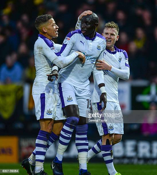 Mohamed Diame of Newcastle United celebrates with teammates Dwight Gayle and Matt Ritchie after scoring Newcastle's second goal during the Sky Bet...