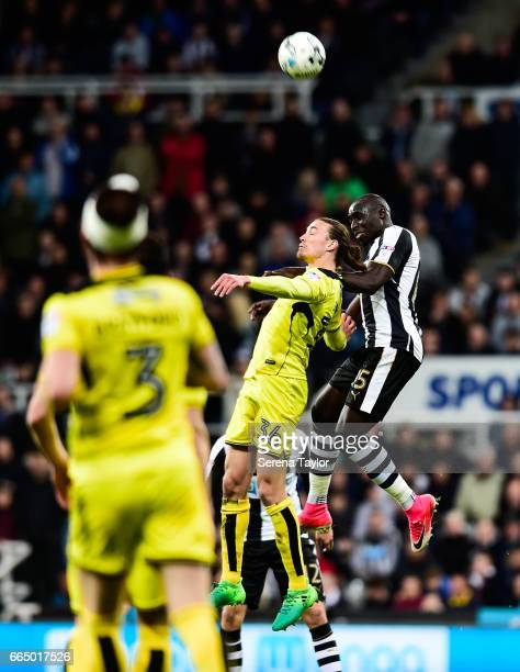 Mohamed Diame of Newcastle United challenges Jackson Irvine of Burton Albion to win a header during the Sky Bet Championship Match between Newcastle...