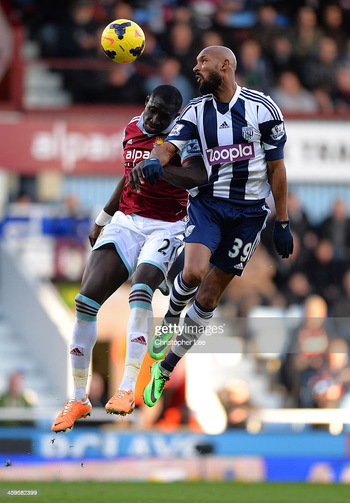 Mohamed Diame of West Ham and <a gi-track='captionPersonalityLinkClicked' href=/galleries/search?phrase=Nicolas+Anelka&family=editorial&specificpeople=206204 ng-click='$event.stopPropagation()'>Nicolas Anelka</a> of West Brom go up for a header during the Barclays Premier League match between West Ham United and West Bromwich Albion at Boleyn Ground on December 28, 2013 in London, England.