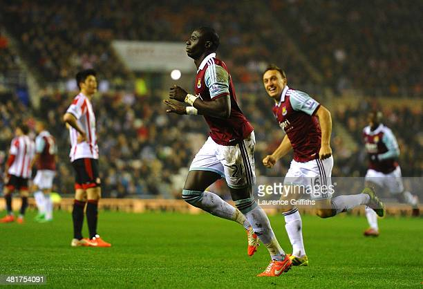 Mohamed Diame of West Ham celebrates with teammate Mark Noble after scoring his team's second goal during the Barclays Premier League match between...