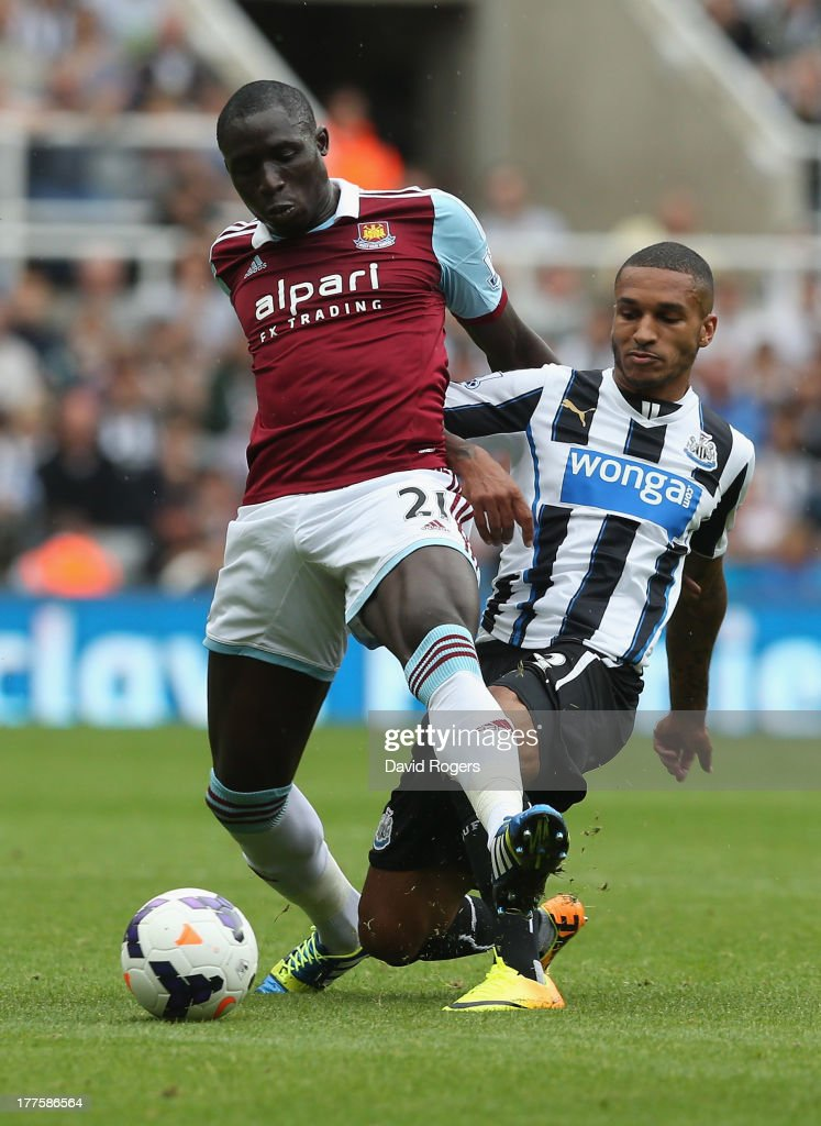 Mohamed Diame of West Ham is challenged by Sylvain Marveaux during the Barclays Premier League match between Newcastle United and West Ham United at St James' Park on August 24, 2013 in Newcastle upon Tyne, England.