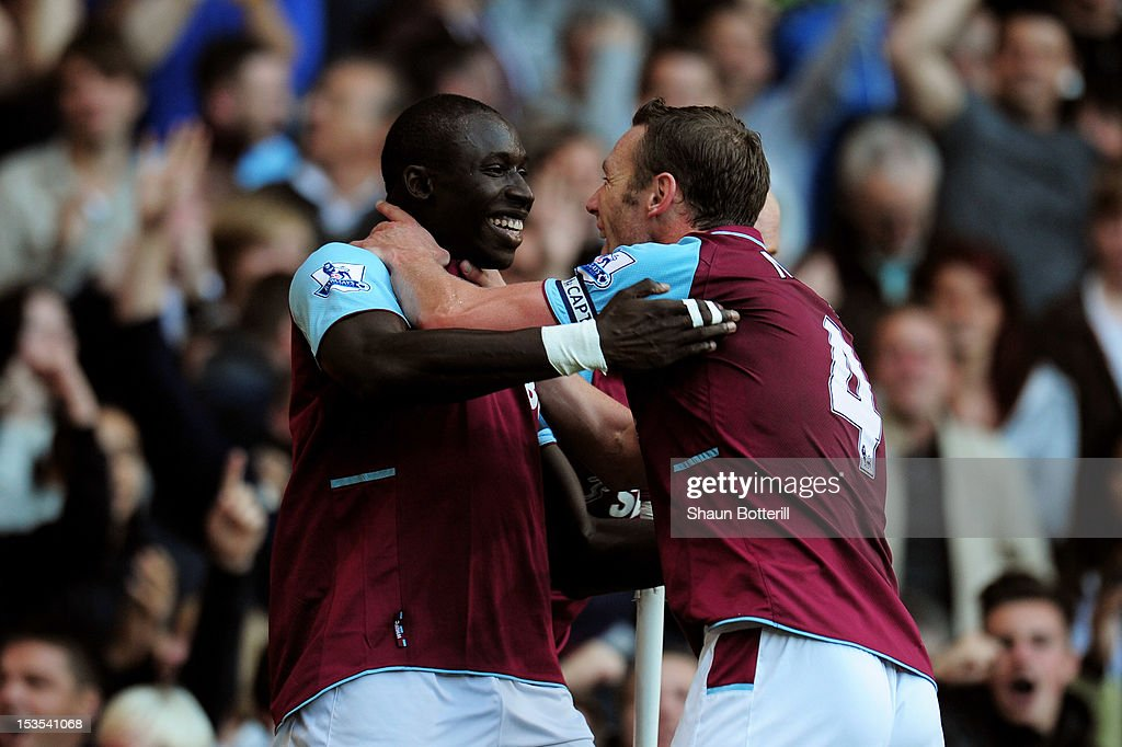 Mohamed Diame (L) of West Ham is congratulated by teammate <a gi-track='captionPersonalityLinkClicked' href=/galleries/search?phrase=Kevin+Nolan&family=editorial&specificpeople=206775 ng-click='$event.stopPropagation()'>Kevin Nolan</a> after scoring the opening goal during the Barclays Premier League match between West Ham United and Arsenal at the Boleyn Ground on October 6, 2012 in London, England.