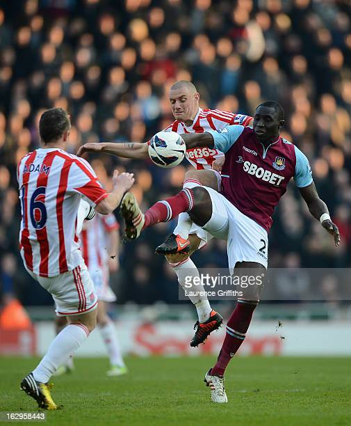 Mohamed Diame of West Ham United battles with Andy Wilkinson of Stoke City during the Barclays Premier League match between Stoke City and West Ham...