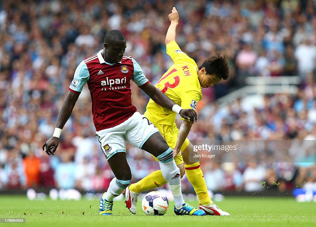 Mohamed Diame of West Ham United battles with Bo-Kyung Kim of Cardiff City during the Barclays Premier League match between West Ham United and Cardiff City at the Bolyen Ground on August 17, 2013 in London, England.