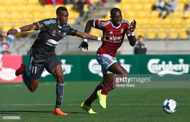 Mohamed Diame of West Ham United beats the tackle of Bernie IbiniIsei of Sydney FC during the Football United New Zealand Tour 2014 match between...